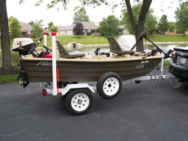 Sundolphin Pro 102 Boat, Motor, Trailer and Accessories for sale in
